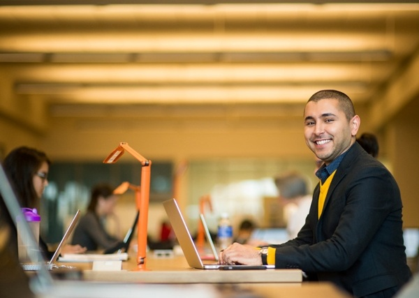 Graduate student Mohamed Azuz studying at the Mary Idema Pew Library Learning and Information Commons